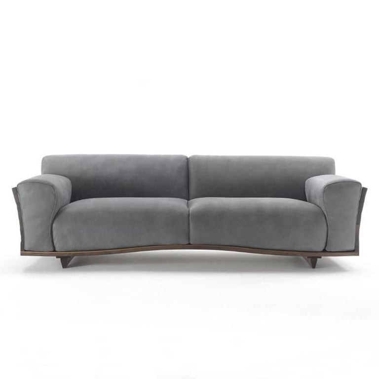 Sofa extreme wood with structure in hand-carved, hand-polished, hand-patinated solid walnut wood. Subtle wood work upholstered with seat and back with high quality genuine grey leather.  Also available with structure in oak or cherry or maple or