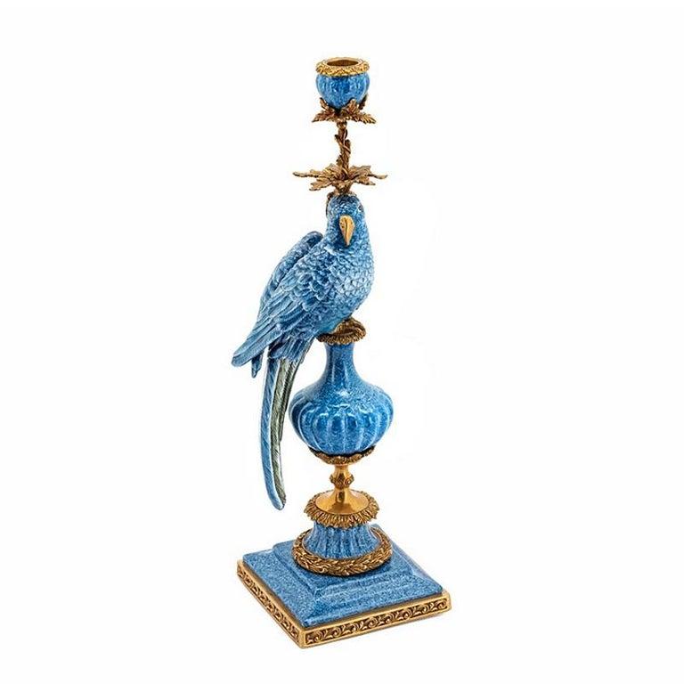 Candleholder blue parrot set of 2 in hand-painted blue porcelain, glazed porcelain. Handcrafted details in solid bronze.