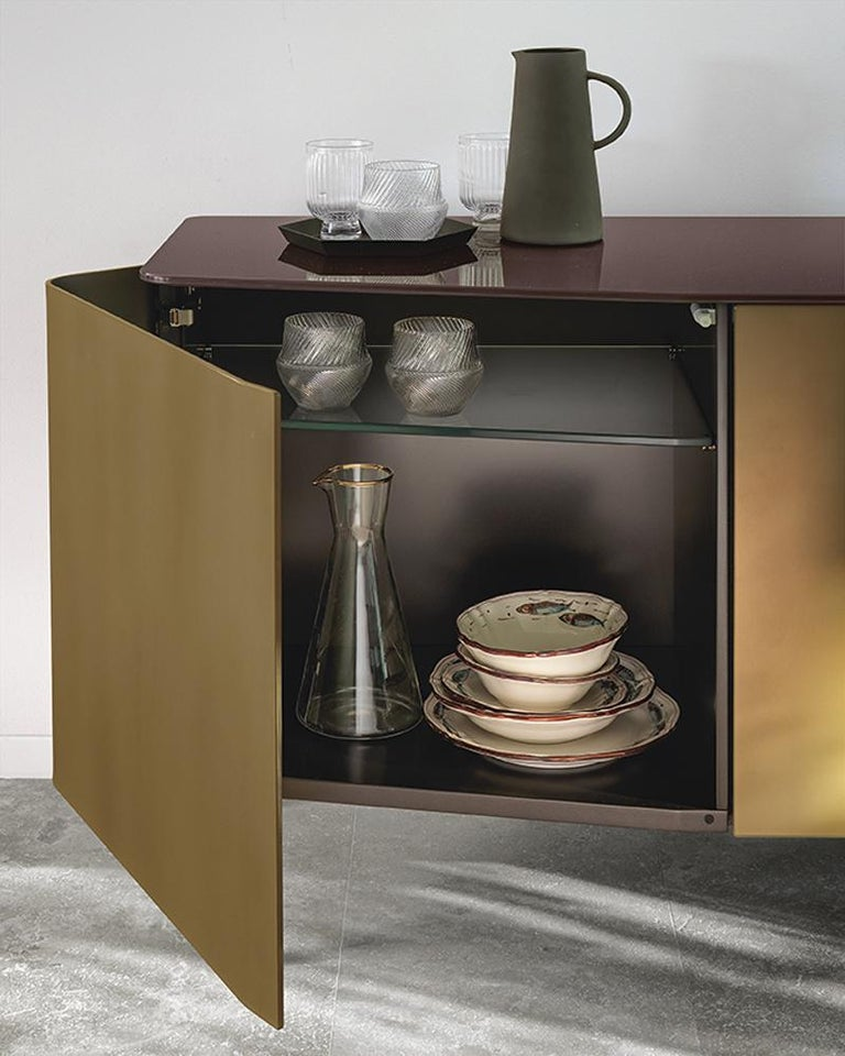 Sideboard flat glass wth structure in lacquered wood. Doors in 6mm extralight curved acid-etched glass in  gold brown finish. With 10mm extralight black-lacquered flat glass top. L180xP50xH72cm, price: 10500,00€ Also available with doors in 6mm