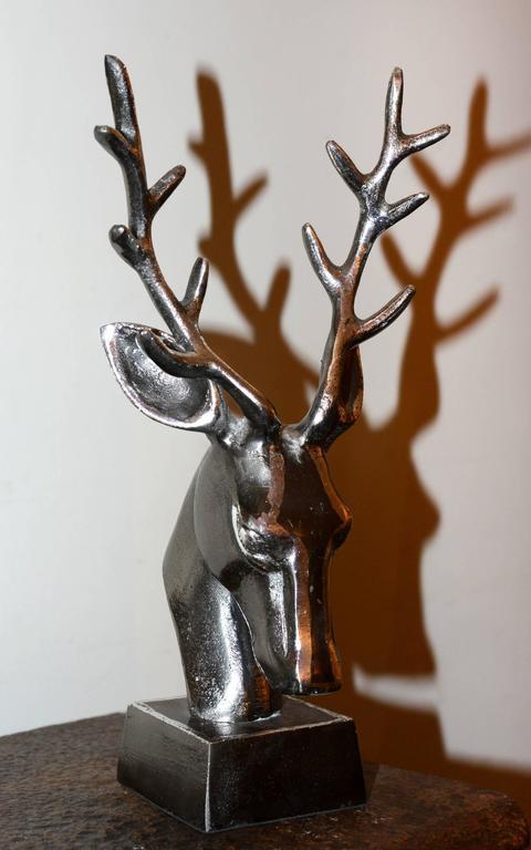 Trophy dear hunter in iron, on base.