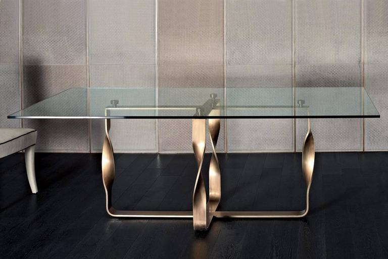 Table torsade with bronze legs structure and massive glass top. Available with genuine leather legs structure, price: 14500.00€.
