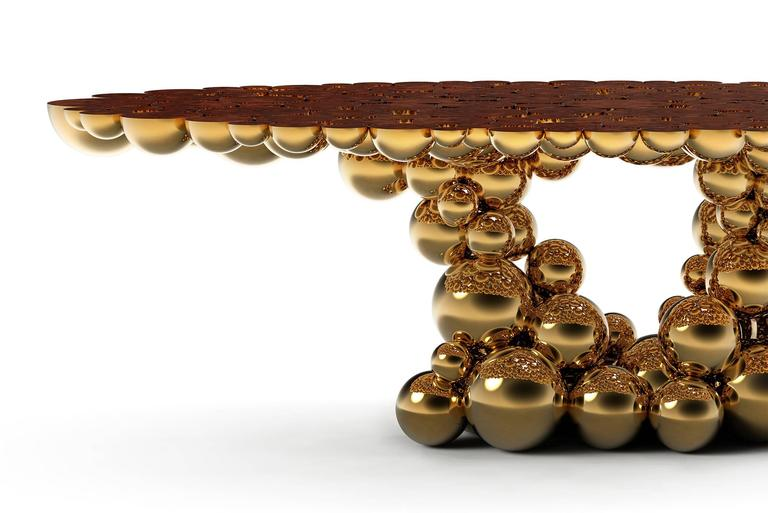 Dining table or conference table spheres golded composed by metallic spheres and semi spheres joined together. Aluminium gold finish. Exceptional piece. Available in console and side table.