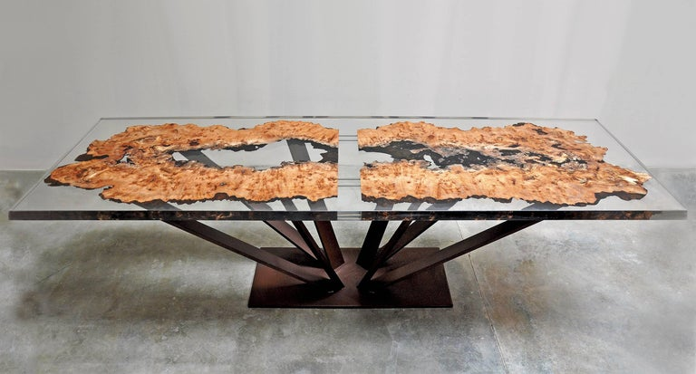 Dining table or conference table in solid elmwood made with the cut of an elm coated with a strong transparent resin. Top thickness: 5 cm. Base composed of eight forged metal feet. Made in France in 2017. Exceptional and unique piece.
