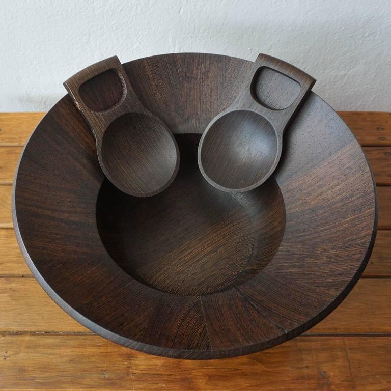 """Wenge salad bowl and tongs by Jens Quistgaard. Part of the Dansk """"Rare Woods"""" line. Made in Denmark. Signed on the bottom of the bowl and tongs, 1960s."""
