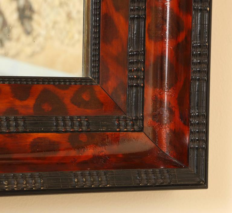 Mid-20th Century Ebonized and Lacquered Faux Tortoise Shell Decorated Mirror Frame For Sale