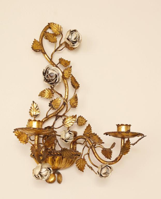 A charming and chic pair of Italian painted floral and gilt metal wall sconces with two candle arms. (Can be electrified if desired).