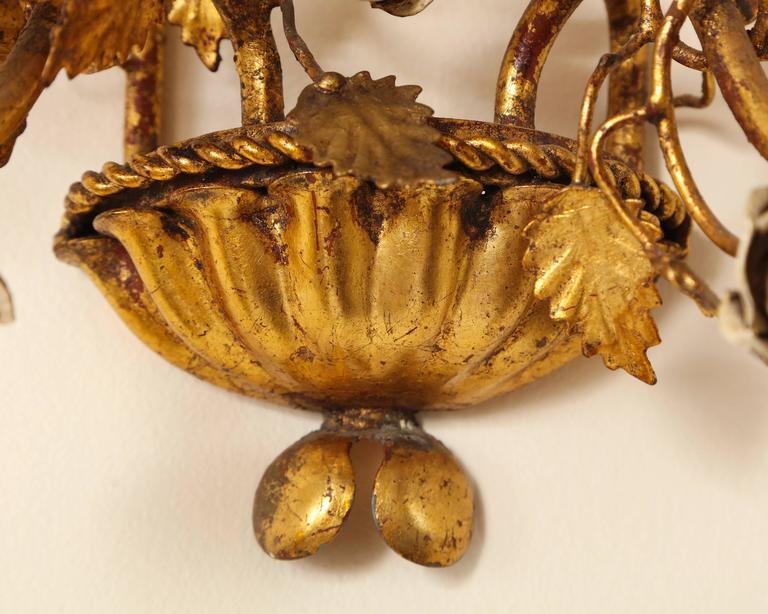 Mid-20th Century Pair of Italian Painted Floral and Gilt Metal Wall Sconces with Two Candle Arms For Sale