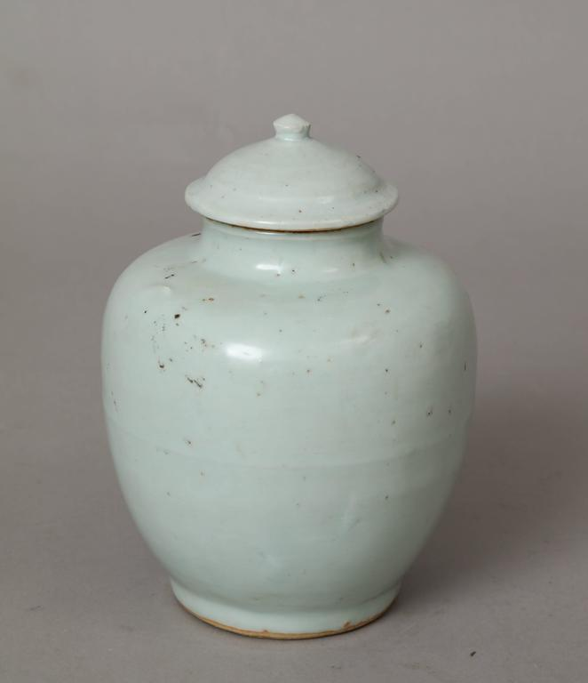 """A Ming dynasty Chinese whitish blue-grey porcelain baluster form vase with lid. The color of this vase is translated from the Chinese as """"the blue of the morning sky after the rain.""""  Ming dynasty, circa 1500. Size: 8 ½"""" high x 5"""""""