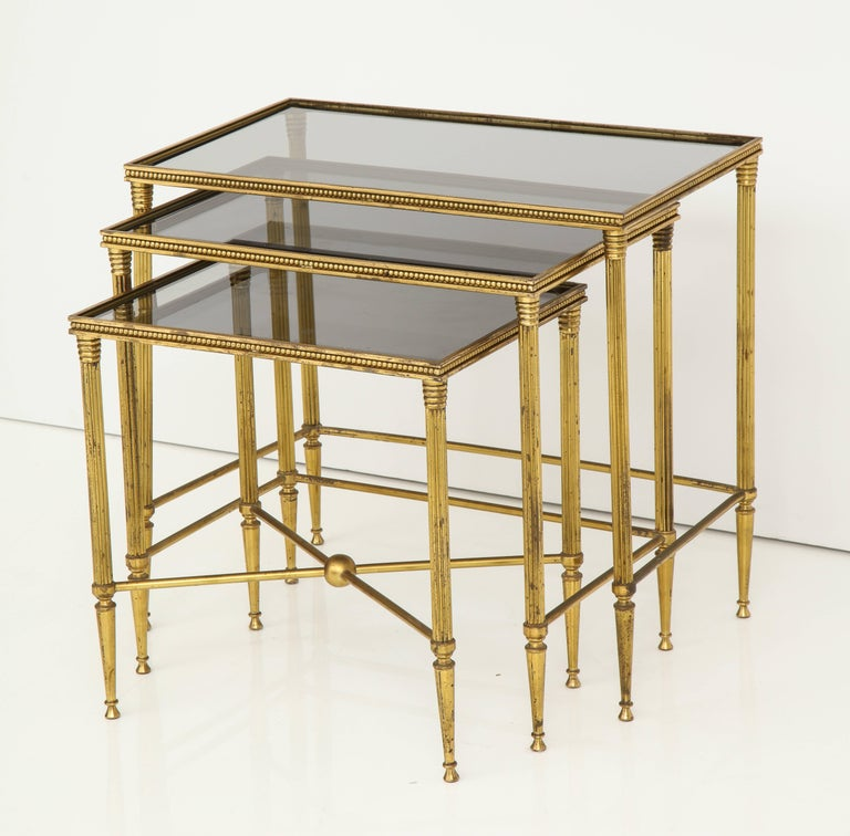 Italian brass nesting tables with inset smoked glass tops for Glass top nesting tables
