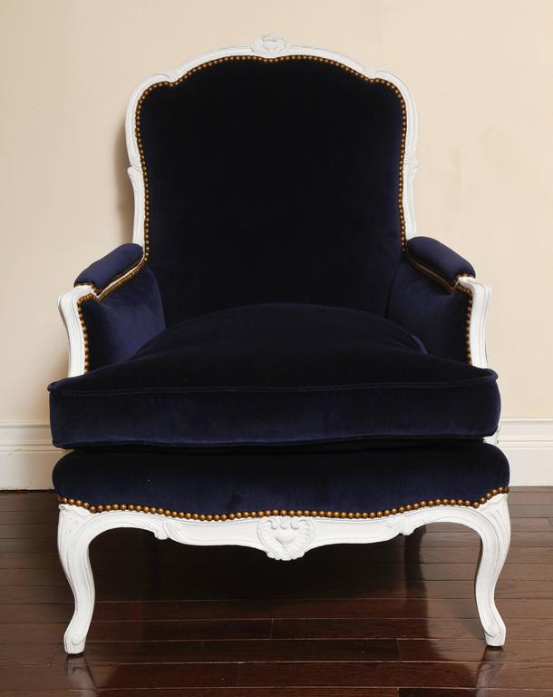 Louis XV French 19th Century Large Painted White Bergere with Blue Velvet Upholstery For Sale