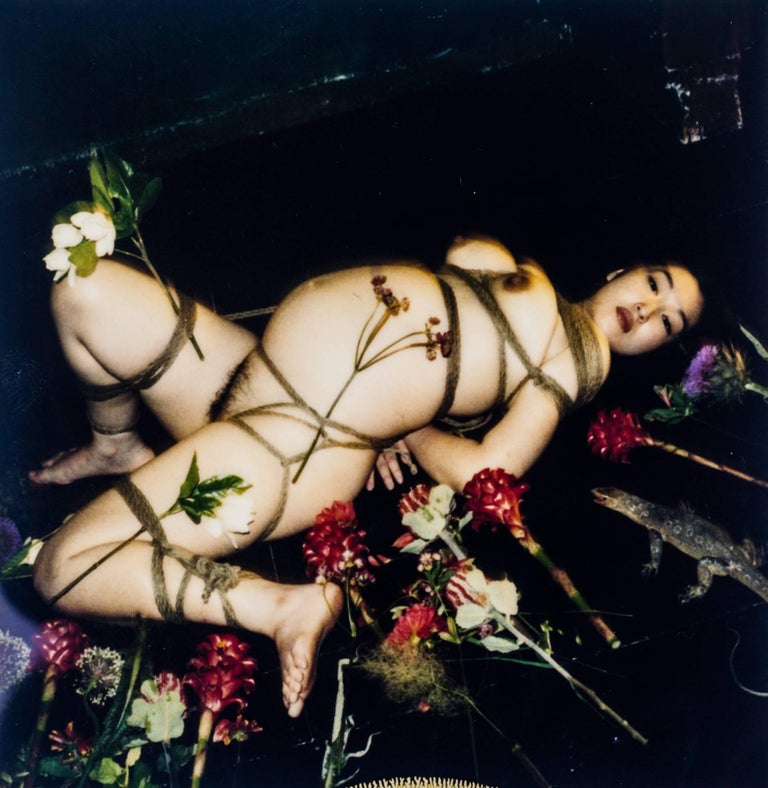 Polaroid by Nobuyoshi Araki, circa 1996. Signed on reverse. The most emblematic of Araki's Polaroid work, at the climax of his research, career and master-craft. It contains all the elements of Araki's mythology: The nude model in traditional