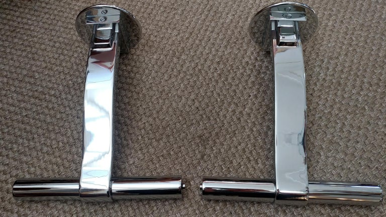 Pair of fabulous polished chrome sconces or bedside reading lamps. They are in great vintage condition.