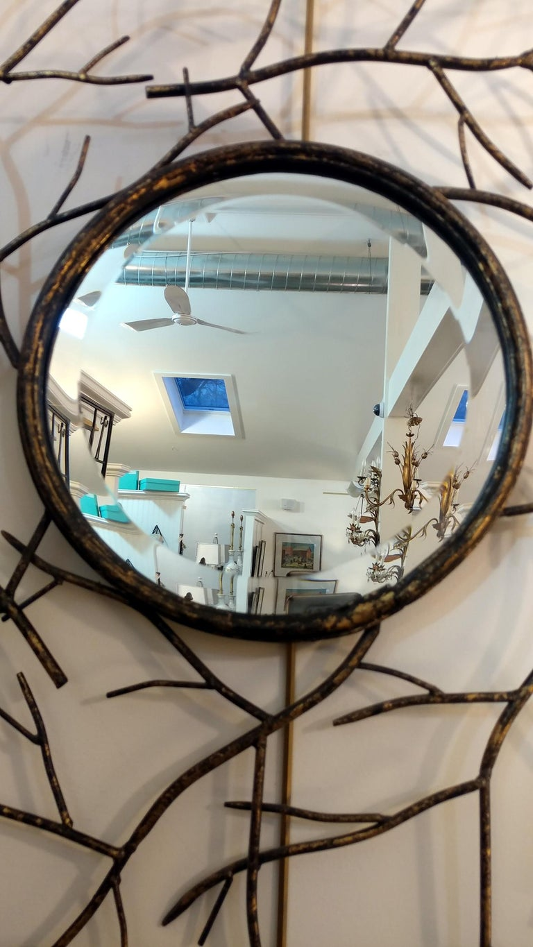 Striking les branches convex mirror, lovely patinated gilt on wrought iron twigs frame. Beveled edge on mirror, circa 1970s, in overall good vintage condition, there's a 2 inch hairline on mirror surface, though it is not too noticeable, we can also