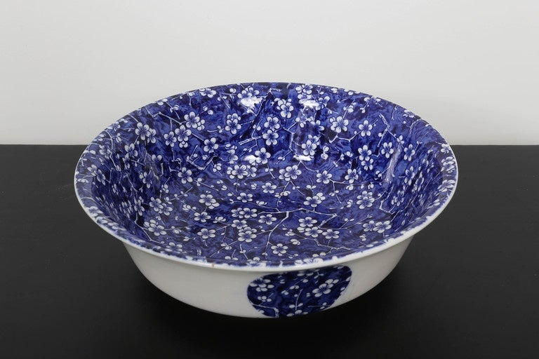 This large Minton bowl in the Hawthorn pattern consists of various shades of blue with white flowers and branches. Outside design, white background with large medallion designs in blue.