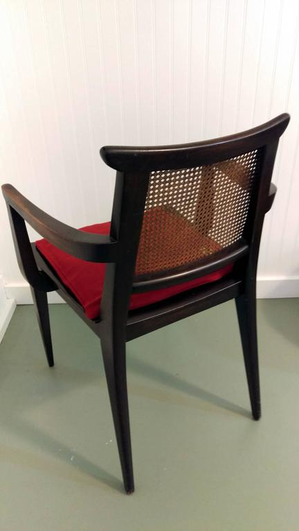 A handsome and well proportion designed armchair by Edward Wormley. Made of dark mahogany contrast with cane back, tapered legs and loose upholstered seat, circa 1950s. Wear and scuff on seat area, arm shown original patina, refer to pictures. Wear