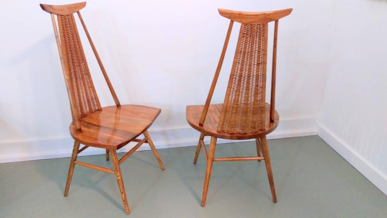 Extremely rare and exquisite pair of easy chairs by Finnish Architect Ilmari Tapiovaara. The chairs are fine example of Tapiovaara known to combine modern design aesthetic and Finnish peasant tradition. The use of solid wood added to the aura of