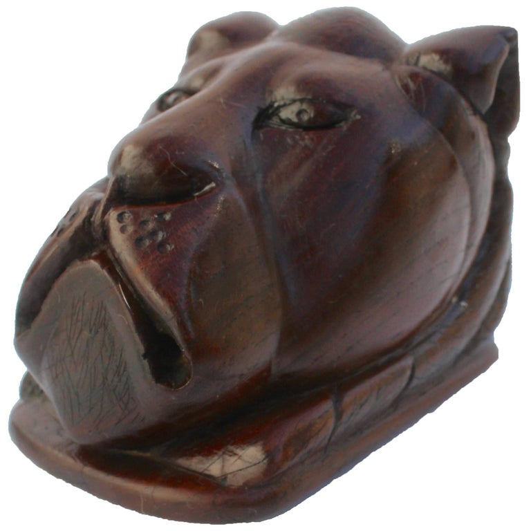 Paperweight Made of Hardwood Carving Depicting a Animal Head For Sale