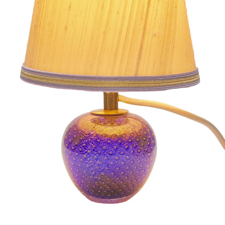 Vintage Murano globe-shaped lamp made in cobalt blue with aventurine (gold metal) and bullicante decor (finely controlled bubbles). Ideal for a bedside or side table, when lit it gives a dramatic jewel-like effect This solid lamp base, complete with