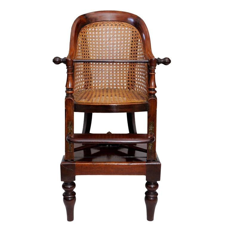 This is a most interesting English George III late 18th century mahogany childs chair and table.