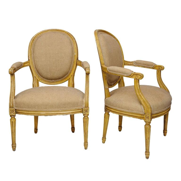 Pair of French Neoclassical Painted Louis XVI Open Armchairs, circa 1780