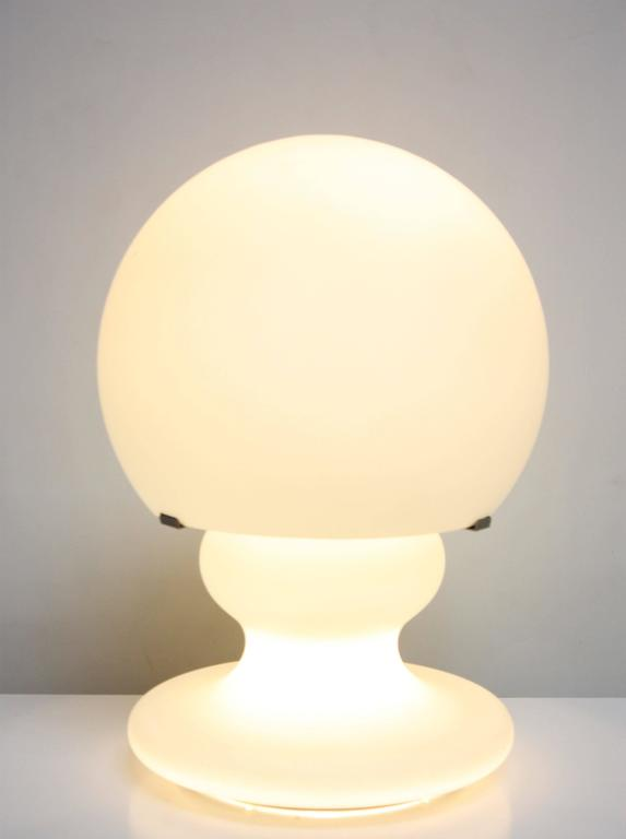 """This spectacular, large Italian table lamp is comprised of two sections: The frosted glass dome mounts to the sculptural base. The lamp has been fully rewired, but the original 'on / off"""" polished chrome square switch was salvaged.  We"""