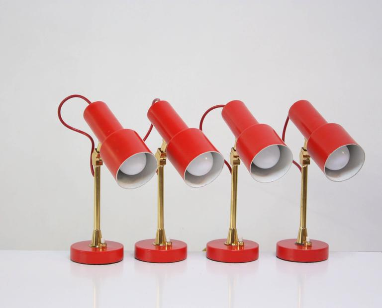 These small, adjustable Stilux table lamps are in original condition, retaining their original red paint and all solid brass hardware (screws). They have been completely rewired and are ready for use. They came from the Hotel Irma in Chianciano