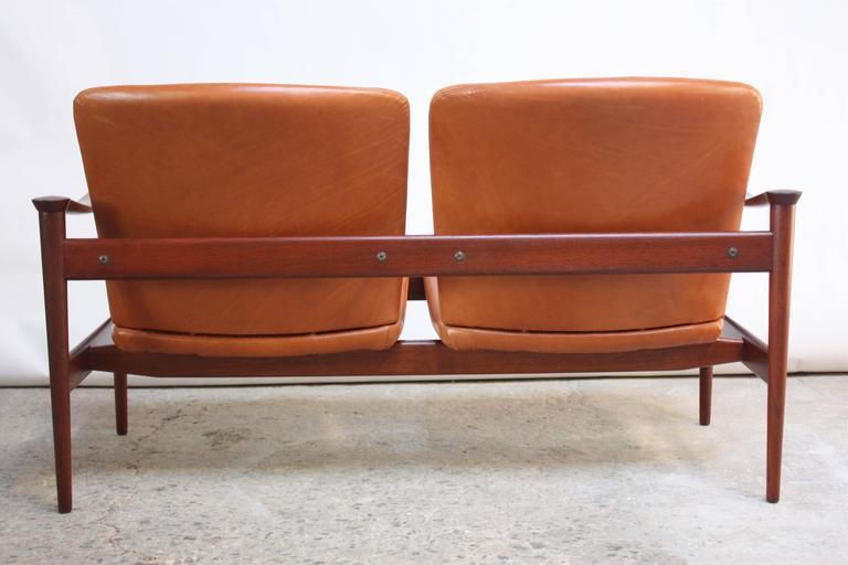 Mid-Century Modern Fredrik Kayser Loveseat in Leather and Teak For Sale