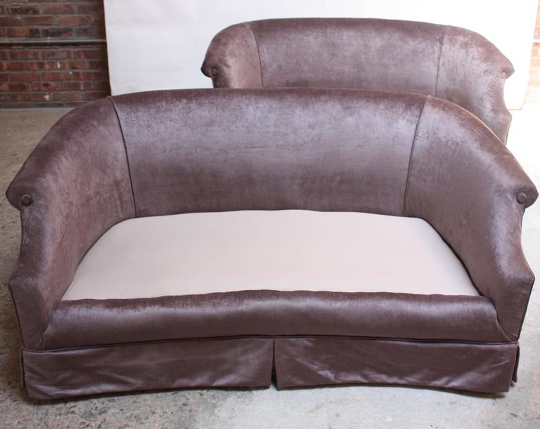 These glamorous settees in light lavender velvet feature low back, rolled-arm frames and spring-construction. The seat cushions were purposefully designed to be relatively high for additional support but could easily be modified and lowered to