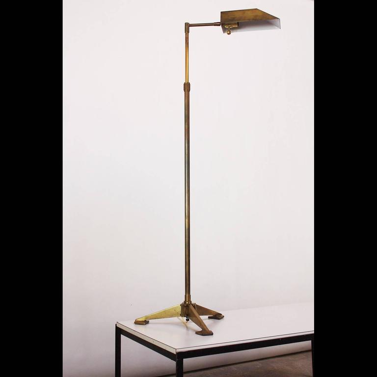 This solid brass Chapman floor lamp features an elegant shade (offering full 360 degree adjustability) and tubular brass stem supported by a raised tripod base. Comprised entirely of brass this piece also features the signature bronze finish and