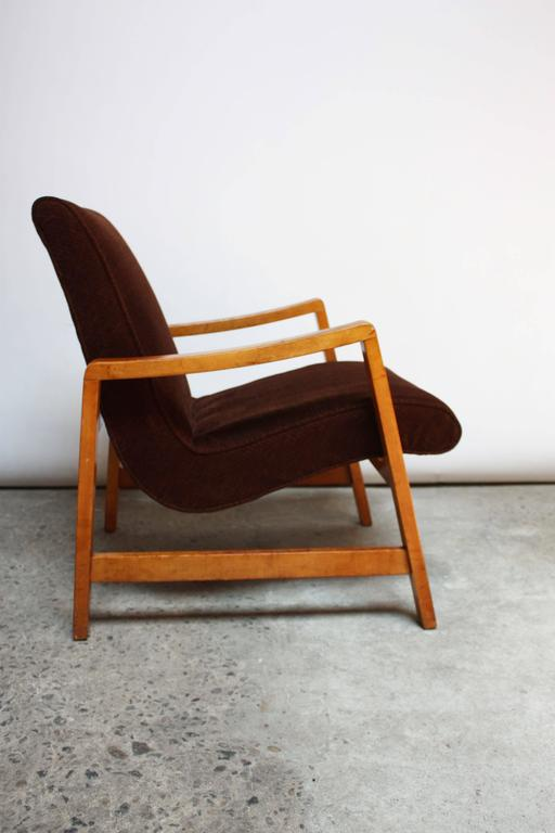 This armchair is an early example of Jens Risom's design for Knoll and is a simple yet innovative design. The chair is two separate pieces: a singular seat / back component is simply inserted directly into a frame supported by a series of inset