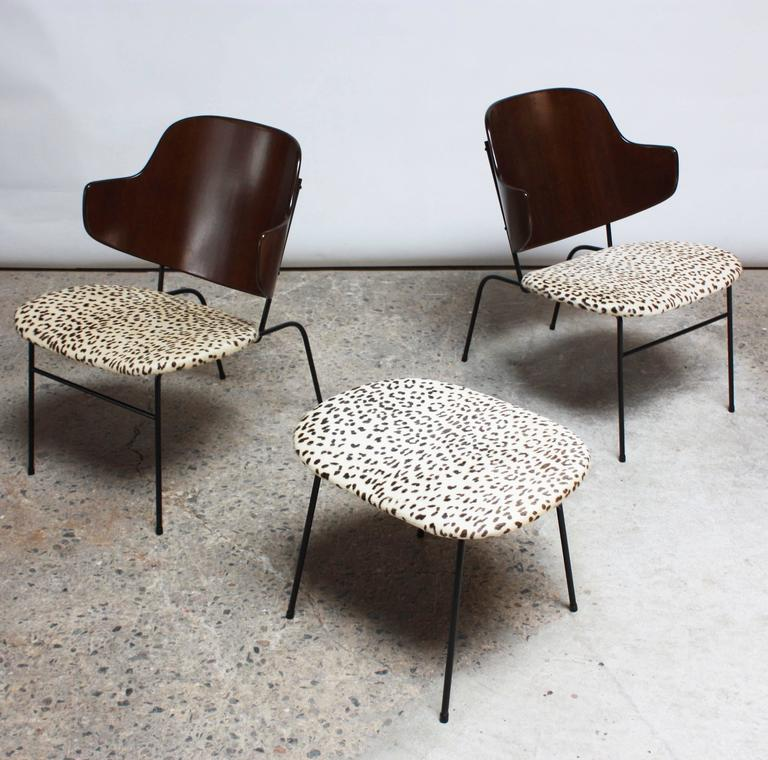 These desirable IB Kofod Larsen 'Penguin' lounge chairs are the rare lower / wider versions with the extended iron frames and dark walnut stained bentwood backs. The upholstery is real appaloosa (pony) hair in a leopard print pattern. There is a