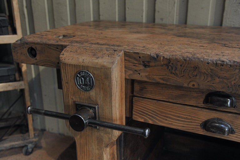 Large carpenter workbench mostly in ash tree, with Vice (working) 6 drawers and 1 door. Depth without Vice (working): 64 cm, circa 1920.