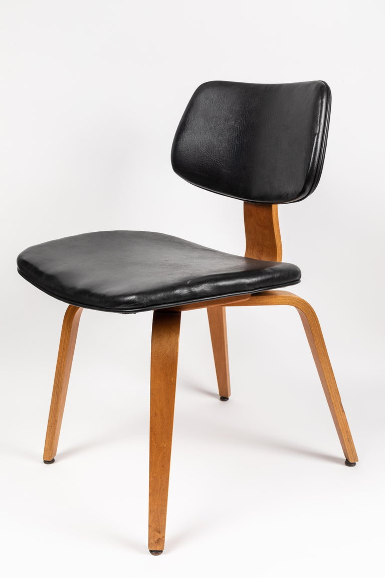 Set of five 1950s Thonet bentwood chairs. Executed in bentwood with black vinyl seat and back.  Price is for the set.  Thonet was one of the most important innovators in 20th century furniture, and this was one of its most innovative designs,