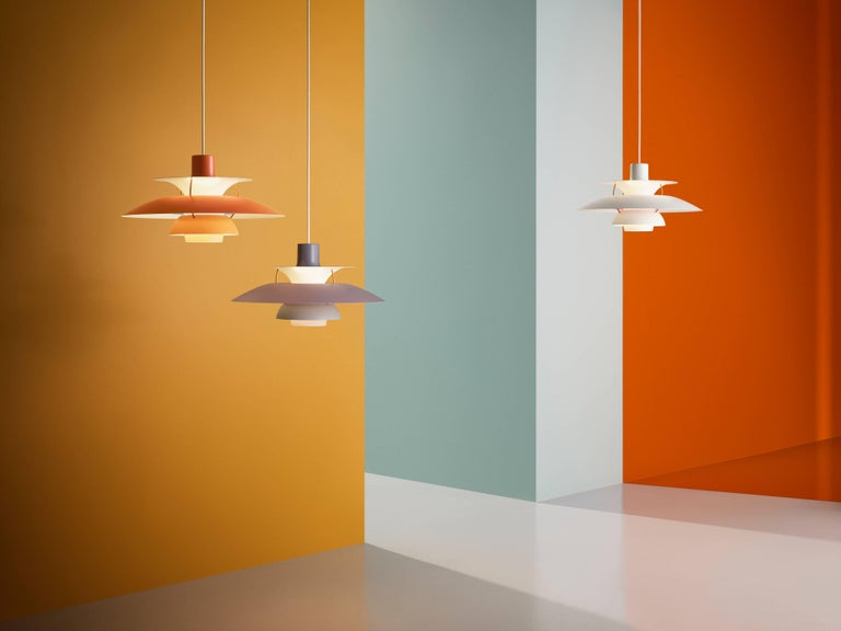 Poul Henningsen PH 5 pendant for Louis Poulsen in orange. Poul Henningsen introduced his iconic PH 5 pendant light in 1958. Six decades later, the PH 5 remains the bestselling design in the Louis Poulsen's portfolio. The PH 5's painted metal shades