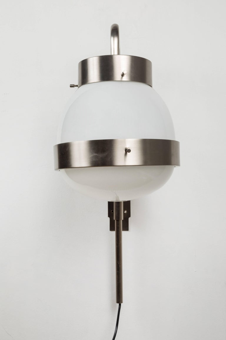 1960s Sergio Mazza 'Delta' wall lights for Artemide. Executed in brushed nickelled brass, pressed and glossy opaline glass. A highly adjustable light that can be rotated left or right as well as up an down.   Price is per item. Two lamps