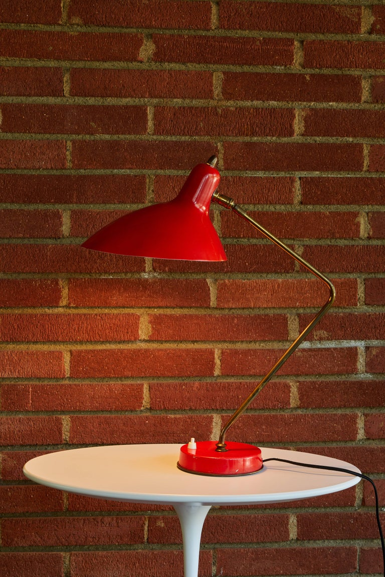 1950s Boris Lacroix table lamp. This rare and elegant table lamp is executed in red metal and brass, France, circa 1950s. A celebrated Art Deco lighting designer who successfully made the transition to Mid-Century Modern idiom, Jean Boris Lacroix's