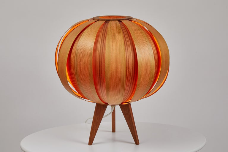 Pair of 1960s Hans-Agne Jakobsson wood table lamps for AB Ellysett. Designed and produced by Jakobsson in Markaryd, Sweden and executed in thin bentwood with solid wood base. A uniquely architectural and rare pair of lamps that are so incredibly