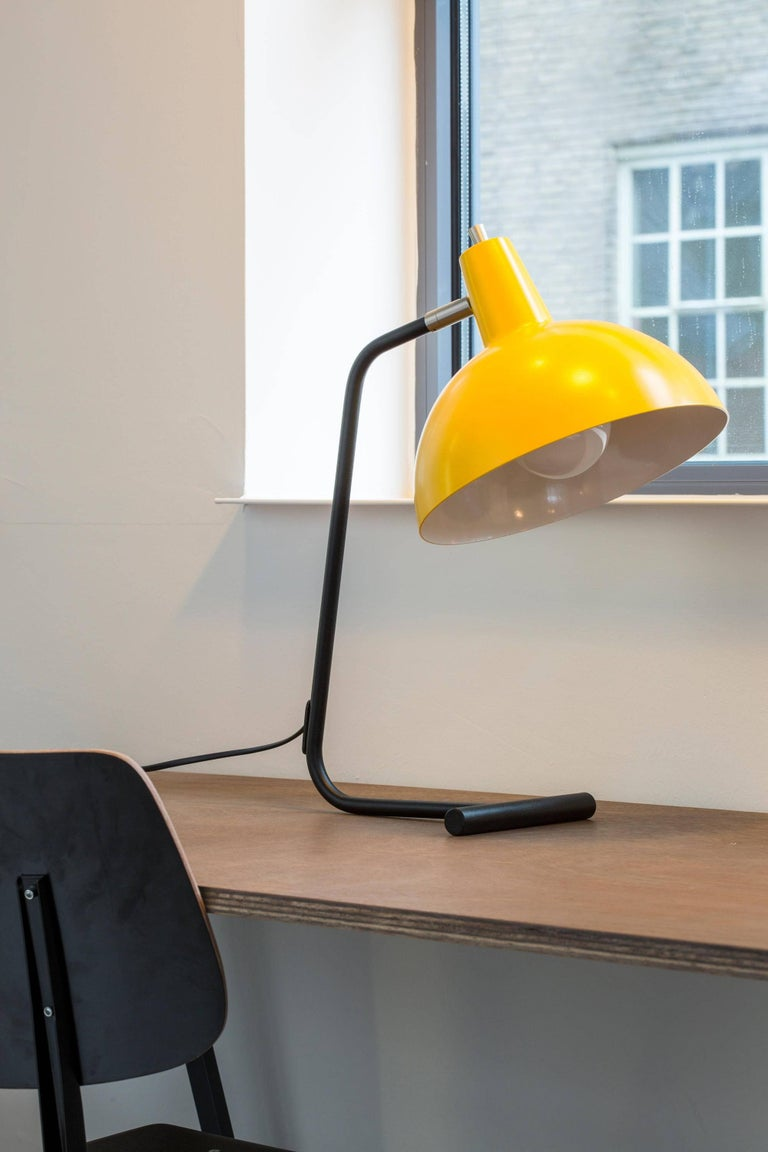 J.J.M. Hoogervorst Yellow 'Director' table light for Anvia. Executed in painted aluminium and steel, with adjustable shade. Based on the original and rare type 6019 table lamp from the 1960s. 'The Director' was named in homage to the original