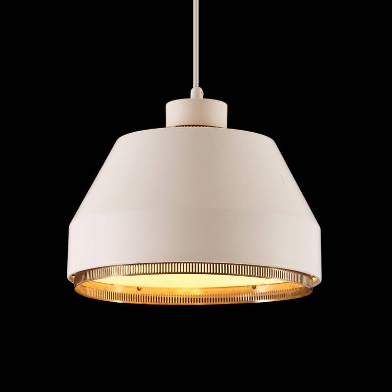 Aino Aalto 'AMA 500' pendant light, 1940s. Executed in enameled aluminum and brass for Valaistustyö Ky Finland, circa 1941. Signed with impressed manufacturer's mark to fixture: Valaistustyo AMA 500. Literature: Alvar & Aino Aalto design: