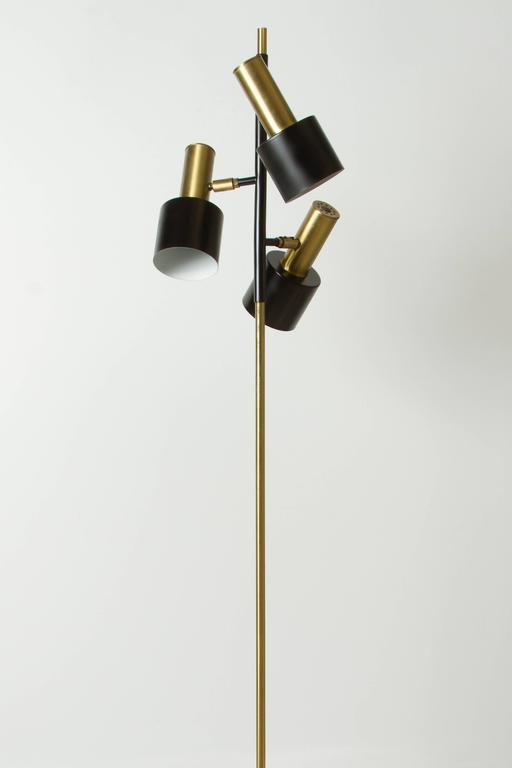 A three cone adjustable floor lamp designed by Jo Hammerborg for Fog & Mørup, Denmark, circa 1960s.