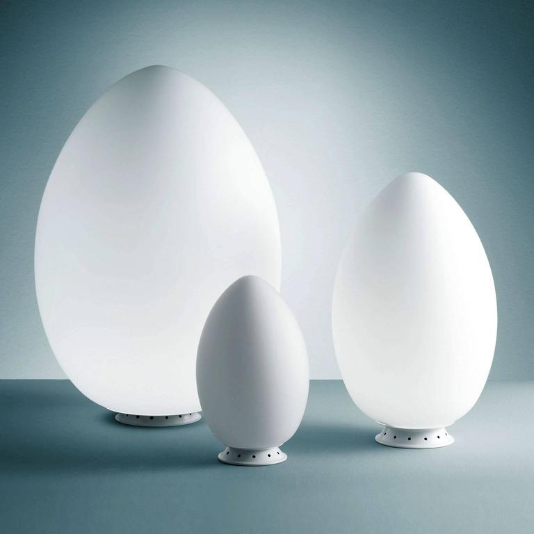 Fontana Arte 'Uovo' table lamp. Executed in satin white blown glass diffusers and painted white metal frames. This listing is for the largest size, an outright sculpture of light that will reign supreme in any room. Also available in small ($480)