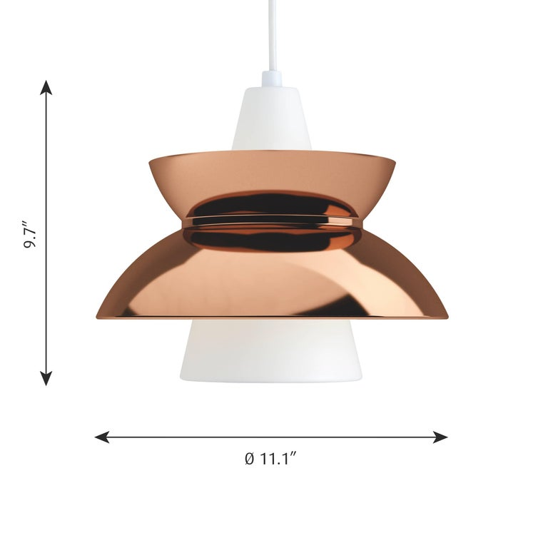Jørn Utzon copper 'Doo-Wop' pendants for Louis Poulsen. Originally designed in the 1950s and re-editioned in the 2010s. Available in stainless steel, copper, brass and aluminum versions in white and dark gray. Also available in LED version.