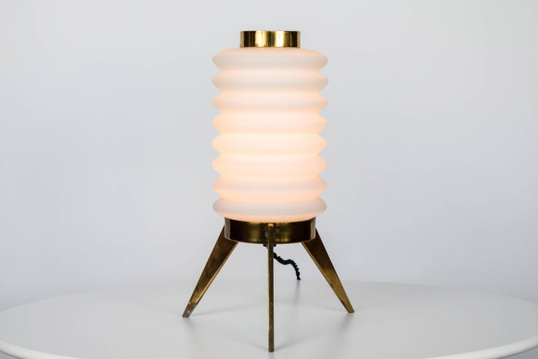 1950s Angelo Lelli glass and brass tripod table lamp for Arredoluce. An extremely rare design executed in patinated brass and sculpturally blown opaline glass. An exquisite example of the iconic early work of Lelli and Arredoluce Monza.