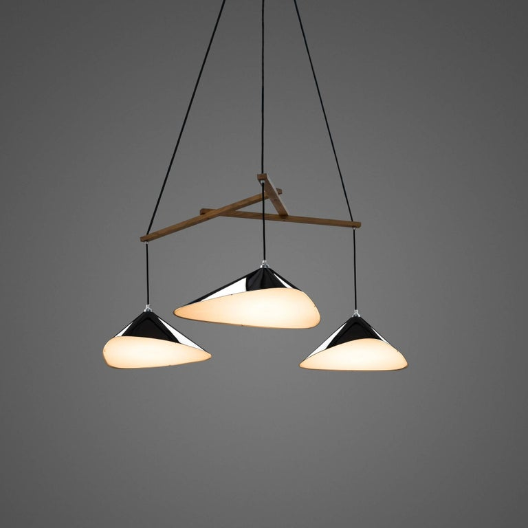 Daniel Becker 'Emily 3' Chandelier in Matte Black. Designed by Berlin luminary Daniel Becker and handmade to order using midcentury manufacturing techniques. Executed in high-quality sheet metal with anthracite matte black paint, a sculptural frame