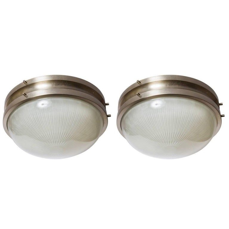 1960s Sergio Mazza 'Sigma' wall or ceiling lights for Artemide, 1960s. Executed in nickeled brass and pressed opaline glass by Sergio Mazza for Artemide, Italy, circa 1960s. Each light has been professionally rewired for US electrical and
