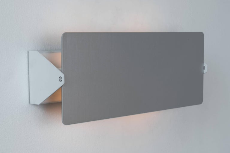 Large Charlotte Perriand brushed aluminium 'CP1' wall lights. Executed in brushed aluminium and white painted metal with adjustable shade.