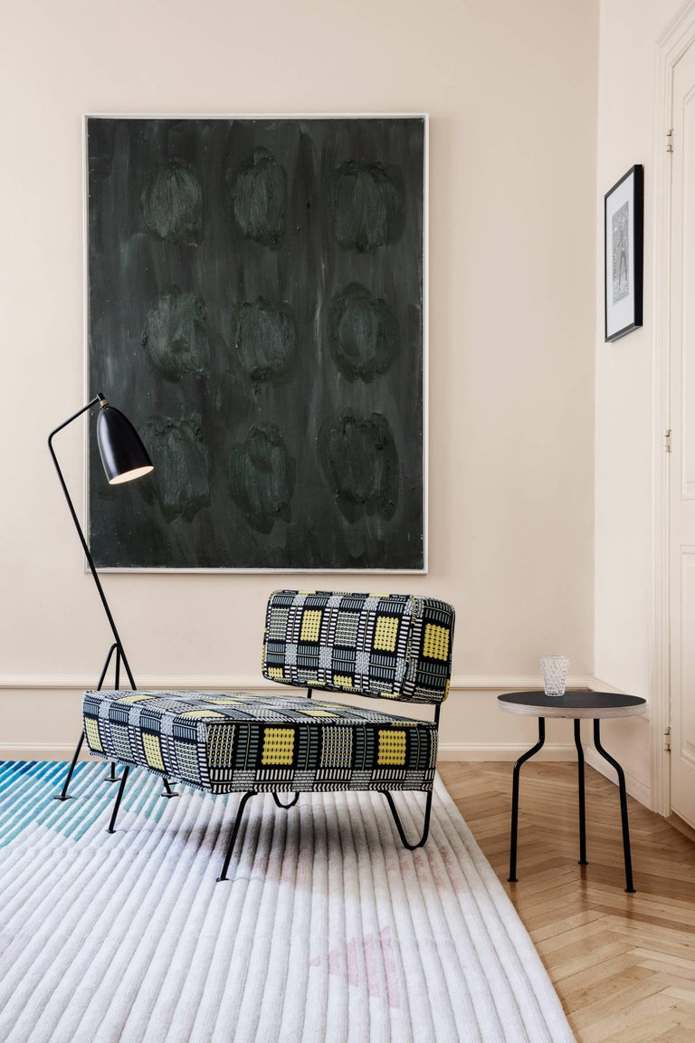 Greta Magnusson Grossman 'Grasshopper' floor lamp in black. Designed in 1947 by Grossman, this is an authorized re-edition by GUBI of Denmark who meticulously reproduces her work with scrupulous attention to detail and materials that are faithful to