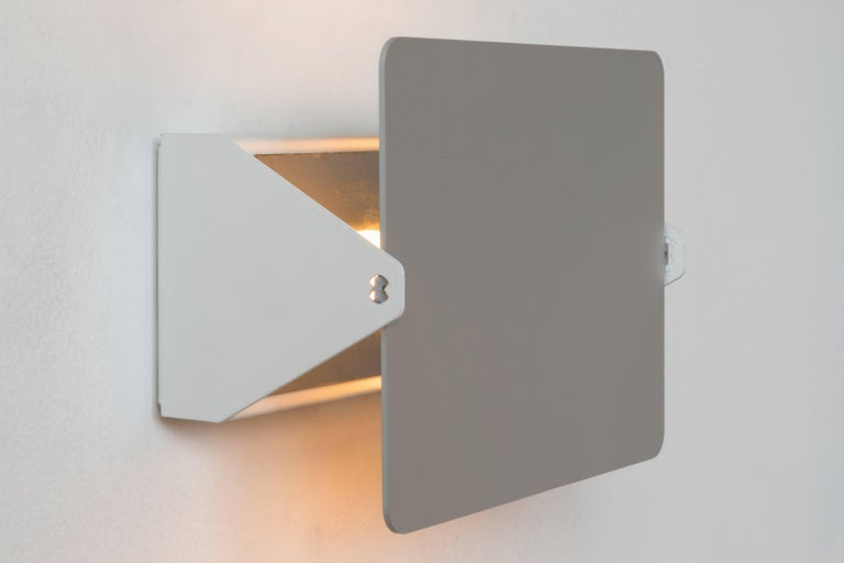 Charlotte Perriand 'CP1' wall lights. A clean and iconic design executed in brushed aluminum and white painted metal.   Price is per item. Professionally rewired authorized reedition from 2010s.