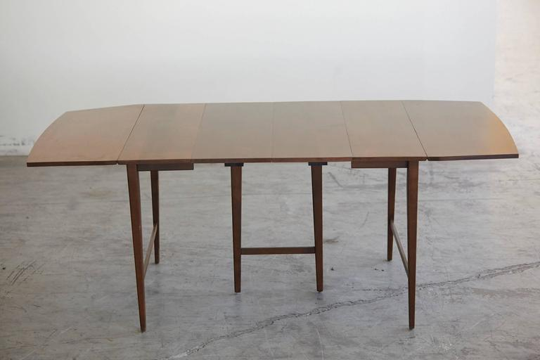 Extendable solid maple drop-leaf dining table with three 12