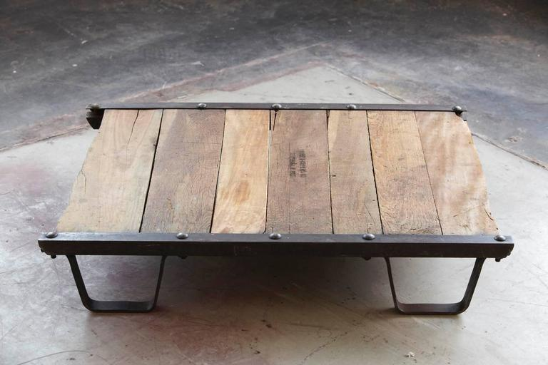 Vintage Industrial wood and steel skid platform low coffee table. Burned in stamp 'Barrett-Cravens Co. Northbrook Illinois'. Barrett-Cravens was a company active in the 1910s-1950s. Great vintage condition with nice patina.